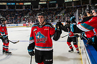 KELOWNA, BC - NOVEMBER 1: Carson Sass #7 of the Kelowna Rockets celebrates a goal with fist bumps along the bench against the Prince George Cougars  at Prospera Place on November 1, 2019 in Kelowna, Canada. (Photo by Marissa Baecker/Shoot the Breeze)