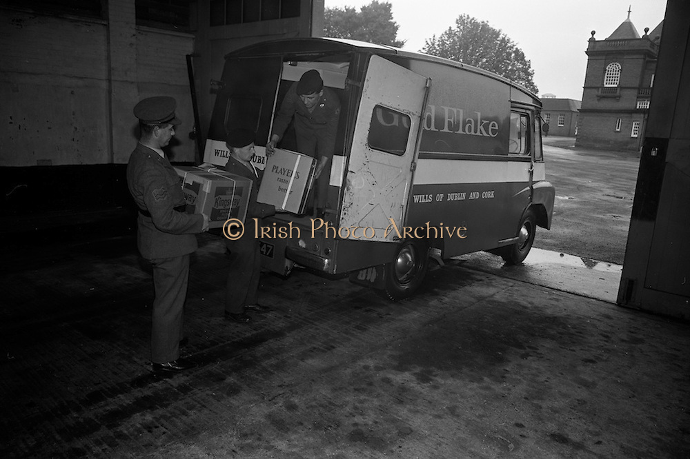 10/10/1966<br /> 10/10/1966<br /> 10 October 1966<br /> Cigarettes for Cyprus Troops. Mr. John Fry, Marketing Manager Player and Wills Ireland Ltd. hands over a gift of fifty thousand specially packed cigarettes to Lt. Col. James Moylett, Manager, Army Canteen Board at McKee Barracks, Dublin. The cigarettes were for the 7th Infantry Group on peacekeeping duty in Cyprus. <br /> Picture shows (l-r): Corporal Frank Louglins; Sergeant Oliver Dennis and Corporal Peter Gavin unloading the cigarettes.