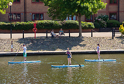 © Licensed to London News Pictures;25/06/2020; Bristol, UK. People paddle board in Bristol docks in sunny weather on the hottest day of the year so far. Photo credit: Simon Chapman/LNP.