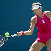 August 16, 2014, New Haven, CT:<br /> Gabrine Muguruza hits a forehand during a match against  Sara Errani on day four of the 2014 Connecticut Open at the Yale University Tennis Center in New Haven, Connecticut Monday, August 18, 2014.<br /> (Photo by Billie Weiss/Connecticut Open)