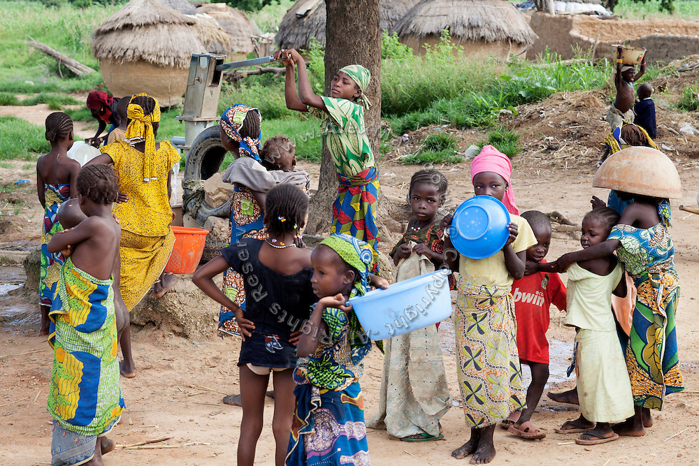 Children are collecting underground water from a hand-pump in Bagega, pop. 9000, a large village affected by lead poisoning due to the unsafe techniques employed for extracting gold, in Zamfara State, Nigeria. It is mainly caused by ingestion and breathing of lead particles released in the steps to isolate the gold from other metals. This type of lead is soluble in stomach acid and children under-5 are most affected, as they tend to ingest more through their hands by touching the ground, and are developing symptoms often leading to death or serious disabilities.