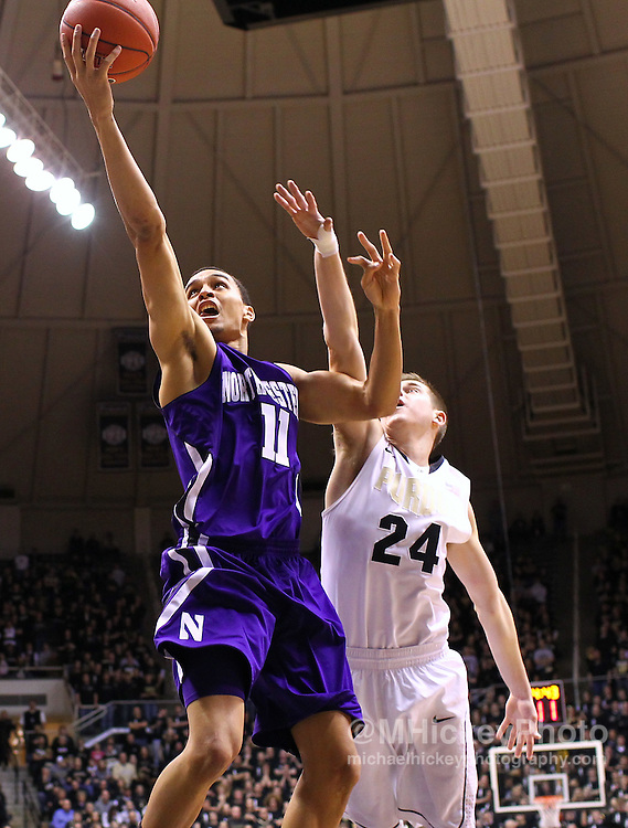 Feb. 12, 2012; West Lafayette, IN, USA; Northwestern Wildcats guard Reggie Hearn (11) shoots the ball as Purdue Boilermakers guard Ryne Smith (24) defends from behind at Mackey Arena. Purdue defeated Northwestern 87-77. Mandatory credit: Michael Hickey-US PRESSWIRE