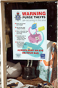 Police notice warning of purse thefts in shop window Britain