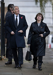© Licensed to London News Pictures. 12/11/2017. London, UK. Former Prime Minister Tony Blair looks up at Number 10 as he walks through Downing Street with his wife Cherie Blair, to attend the Remembrance Sunday Ceremony at the Cenotaph in Whitehall. Photo credit: Peter Macdiarmid/LNP