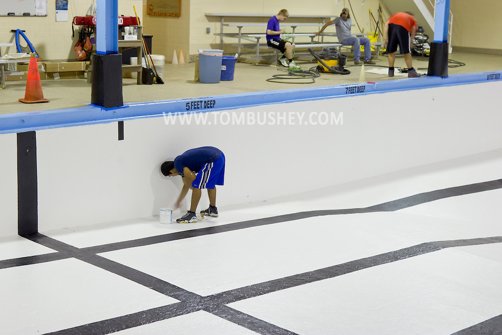 Middletown, New York - Workers paint the empty pool at the Middletown YMCA on Tuesday, Aug. 28, 2012. The pool is briefly closed each year for maintenance.