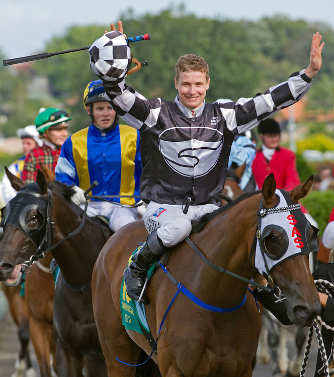 Jockey James McDonald riding Shez Sinsational celebrates winning the Zabeel Classic, Group 1 Race, Christmas Carnival, Ellerslie, Auckland, New Zealand, Monday, December 26, 2011.  Credit:SNPA / David Rowland