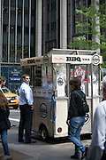Customers stop to buy food from Daisy Mae's BBQ food cart in New York.