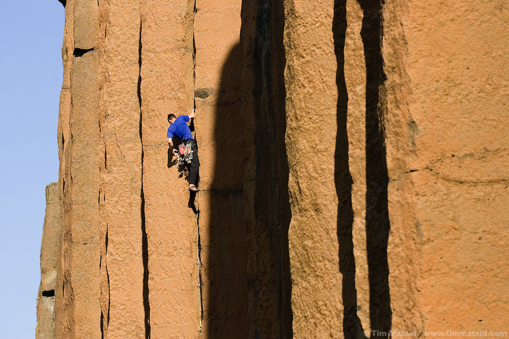 A caucasian mane climbing basalt cracks in Oregon...