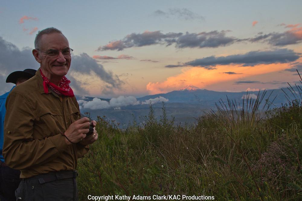 Gary Clark with Cotopaxi volcano in the background, near Quito, Ecuador.