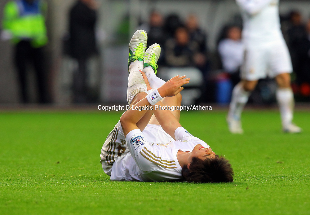 Saturday, 03 November 2012..Pictured: Ki Sung Yueng of Swansea injured on the ground..Re: Barclays Premier League, Swansea City FC v Chelsea at the Liberty Stadium, south Wales.
