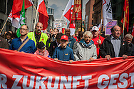 01/05/2015 – Berlin, Germany: People march towards the Brandenburg gate during a Workers Day demonstration organized by DGB, the Confederation of German Trade Unions. The International Workers Day is a celebration of laborers and the working classes that is promoted by the international labor movement, anarchists, socialists, and communists and occurs every year on May Day. (Eduardo Leal)