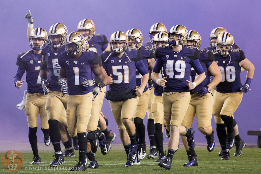 December 2, 2016; Santa Clara, CA, USA; Washington Huskies players run onto the field before the Pac-12 championship against the Colorado Buffaloes at Levi's Stadium. The Huskies defeated the Buffaloes 41-10.