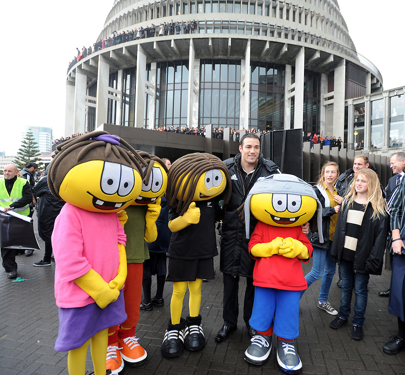 New Zealand's Richard Kahui poses with rugby mascots in front of the Beehive after the Rugby World Cup victory parade through the city ending at Parliament, Wellington, New Zealand, Wednesday, October 26, 2011. Credit:SNPA / Ross Setford