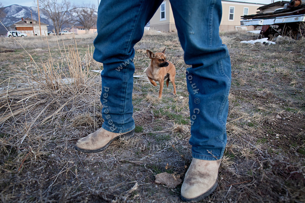 A member of the Goshute Tribe is standing next to his dog in the Goshute Reservation of Deep Creek Valley, on the Nevada-Utah border, USA.