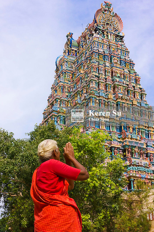 Indian woman praying at Meenakshi Amman Temple complex, Madurai, Tamil Nadu State, India