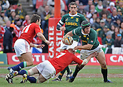 Heinrich Brussow of the Springboks is tackled by Martyn Williams of the Lions with Ruan Pienaar of the Springboks and Harry Ellis of the Lions in support.<br /> Rugby - 090704 - Springboks vs British&Irish Lions - Coca-Cola Park - Johannesburg - South Africa. The Lions won the third test 28-9 but lost the series 2-1 to the Springboks.<br /> Photographer : Anton de Villiers / SASPA