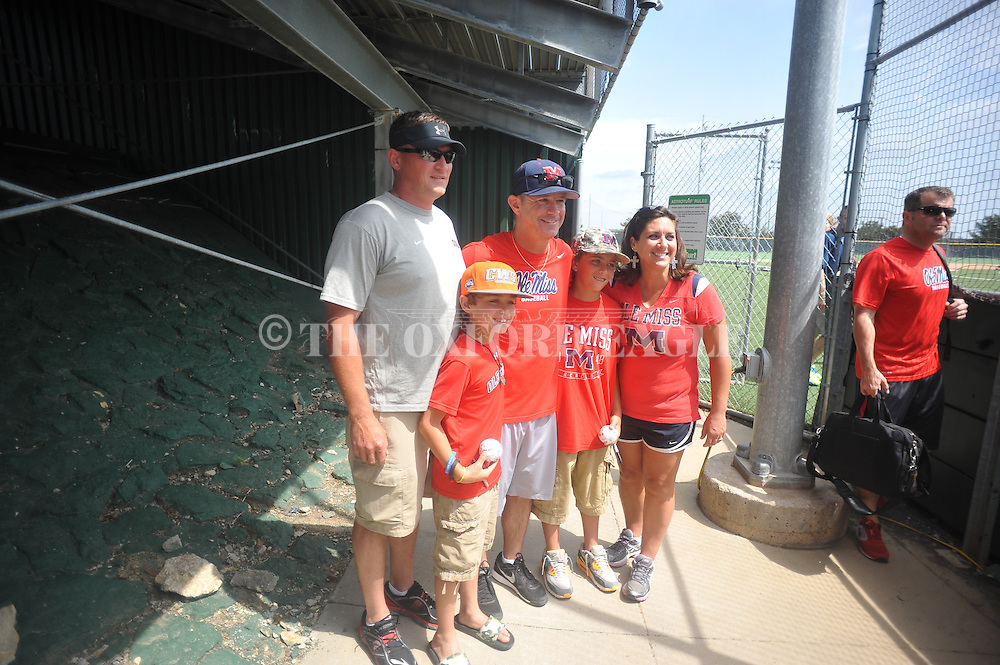 Mississippi head coach Mike Bianco poses with fans following practice at Creighton University in Omaha, Neb. on Wednesday, June 18, 2014.