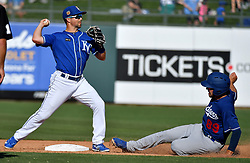 March 12, 2017 - Surprise, AZ, USA - Kansas City Royals second baseman Whit Merrifield forces out Los Angeles Dodgers' Drew Jackson at second and completes the double play on Tyler Holt in the ninth inning during a spring training baseball game on Sunday, March 12, 2017 in Surprise, Ariz. (Credit Image: © John Sleezer/TNS via ZUMA Wire)