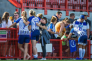 Aileen Whelan (Brighton, Megan Connolly (Brighton) & Beth Roe (Brighton) pose for a photograph following the FA Women's Super League match between Brighton and Hove Albion Women and Chelsea at The People's Pension Stadium, Crawley, England on 15 September 2019.