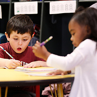 Thomas Wells | BUY AT PHOTOS.DJOURNAL.COM<br /> Titus Larsen works hard to get his letter right as his class works on their names and the alphabet at the Kids Landing Day Care in Tupelo.