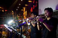 Members of the band play at La Juliana, a top club in Quito, Ecuador.
