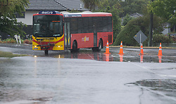 A bus prepares to take a detour around flood water from the Heathcote River in Opawa, Christchurch, New Zealand, Friday, January 5, 2018. Credit:  SNPA / David Alexander