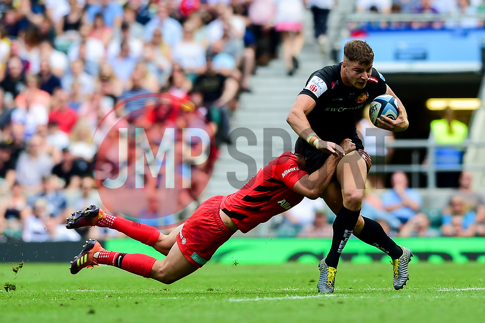 Ollie Devoto of Exeter Chiefs is tackled - Mandatory by-line: Ryan Hiscott/JMP - 01/06/2019 - RUGBY - Twickenham Stadium - London, England - Exeter Chiefs v Saracens - Gallagher Premiership Rugby Final