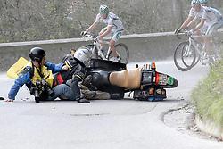 Marina di Carrara Italy 2009 Tirreno - Adriatico Race.Italian Photographer Stefano Sirotti  escapes serious injury as he falls off his Press escort motorbike during stage two.
