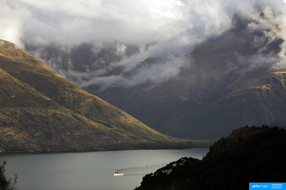 The TSS Earnslaw,  a 1912 Edwardian vintage twin screw steamer on the waters of Lake Wakatipu in, Queenstown, New Zealand. .It is one of the oldest tourist attractions in Central Otago, and the only remaining passenger-carrying coal-fired steamship in the southern hemisphere..The TSS Earnslaw heads along Lake Wakatipu from Queenstown  daily, running tourist trips to Walter Peak Station passing magnificent  peaks and contrasting shoreline foliage along the lakeside. Queenstown, New Zealand. 11th March 2011. Photo Tim Clayton