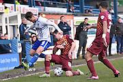 Bradford City Midfielder, Josh Cullen and Bury Midfielder, Andrew Tutte clash during the Sky Bet League 1 match between Bury and Bradford City at the JD Stadium, Bury, England on 5 March 2016. Photo by Mark Pollitt.