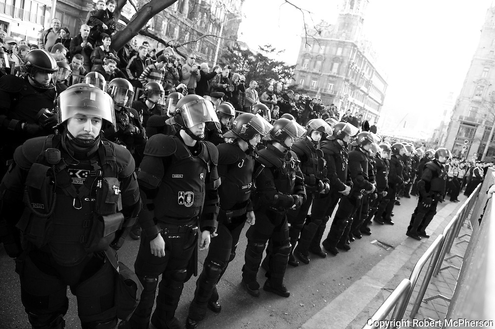 Police separating right-wing extremists from the liberals during a demonstration in Budapest March 2012. <br />
