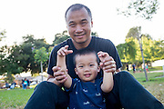 Chun Lin Chen and his son Alex, 3, enjoy Fast Lane Band's performance during the Milpitas Summer Concert Series at Murphy Park in Milpitas, California, on July 14, 2015. (Stan Olszewski/SOSKIphoto)