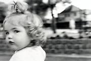 a little girl looking out of the corners of her eyes