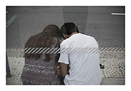 'Young couple at a bus stop, 2013', from 'The Recession Will Not Be Televised' by Colin McPherson, a body of photographic work which looks at the visual representation of the ongoing economic crisis in Porto, Portugal.<br /> <br /> Colin McPherson is a photographer and visual artist born in Scotland in 1964. He works internationally on assignments, commissions and projects. He lives in the north west of England.