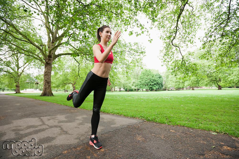 Full length of beautiful fit woman jogging in park