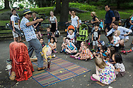 Children at a Puppet Show near the zoo in Central Park