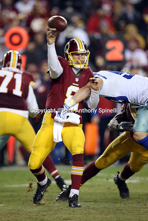Washington Redskins quarterback Kirk Cousins (8) throws an incomplete pass due to pressure from Dallas Cowboys outside linebacker Sean Lee (50) in the fourth quarter during the 2015 week 13 regular season NFL football game against the Dallas Cowboys on Monday, Dec. 7, 2015 in Landover, Md. The Cowboys won the game 19-16. (©Paul Anthony Spinelli)