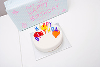 High angle view of birthday cake and gift on table
