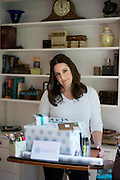 Aaron Leigh Johnson-Horton, founder of The Mesh Warrior, poses for a portrait with gifts she will mail to women with complications from a mesh implant from her home in Dallas, Texas on July 8, 2014. (Cooper Neill for The Texas Tribune)
