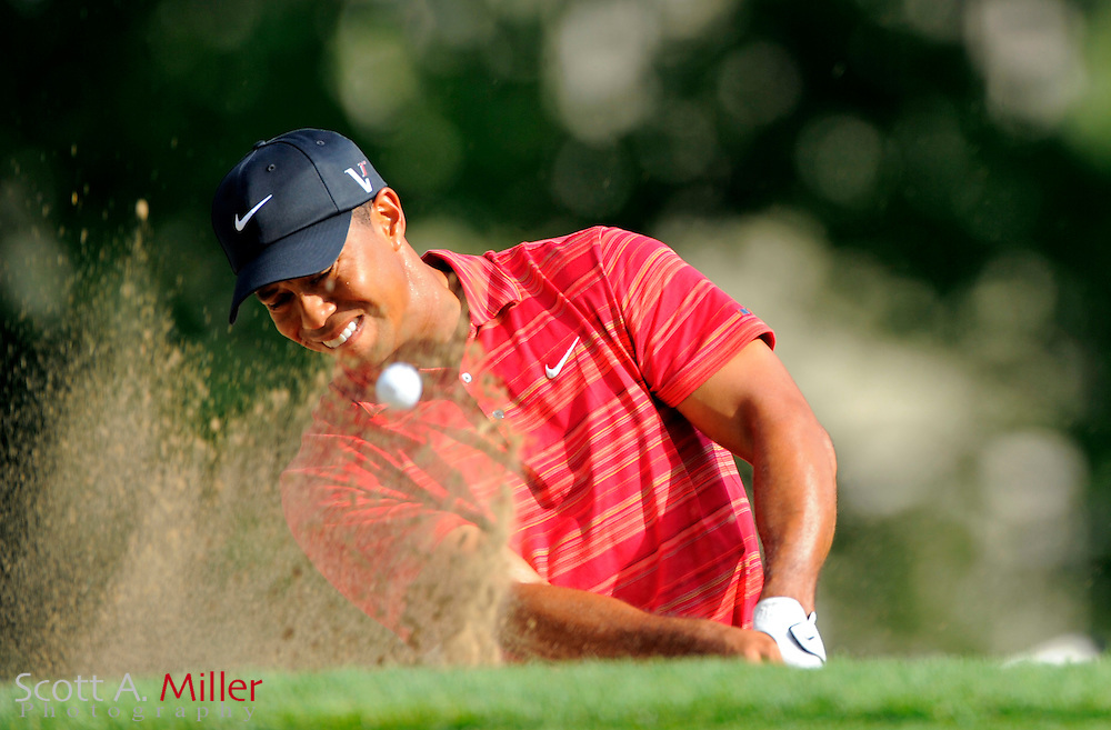 Aug 16, 2009; Chaska, MN, USA; Tiger Woods (USA) hits out of a bunker on the 14th hole during the final round of the 2009 PGA Championship at Hazeltine National Golf Club.  ©2009 Scott A. Miller