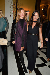 Left to right, MILLIE MACKINTOSH and ROXIE NAFOUSI at a party to celebrate theunveiling of the Claridge's Christmas Tree designed by Christopher Bailey for Burberryheld at Claridge's, Brook Street, London on 18th November 2015.