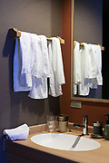 used towels on rack with sink in hotel room Nara Japan