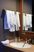 used towels on rack with sink in hotel room Nara Japan