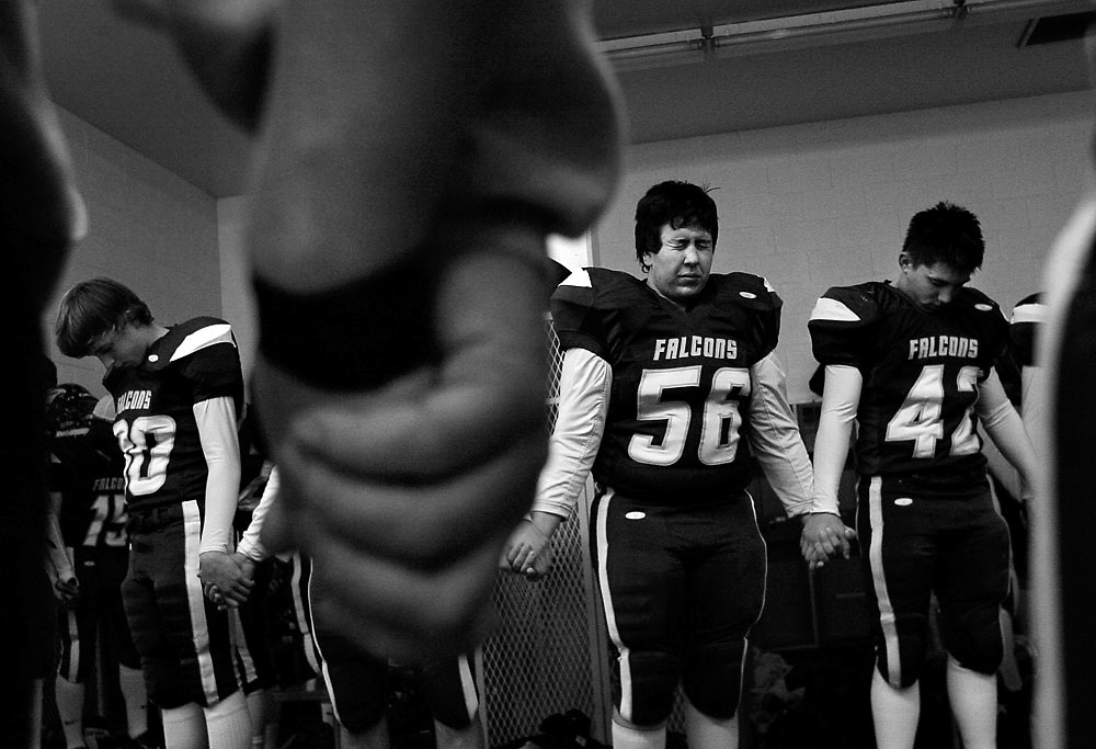 Hanford players and coaches pray before losing to Mt. Spokane 48-13 during a state playoff matchup at Fran Rish Stadium in Richland on Nov. 13, 2009.