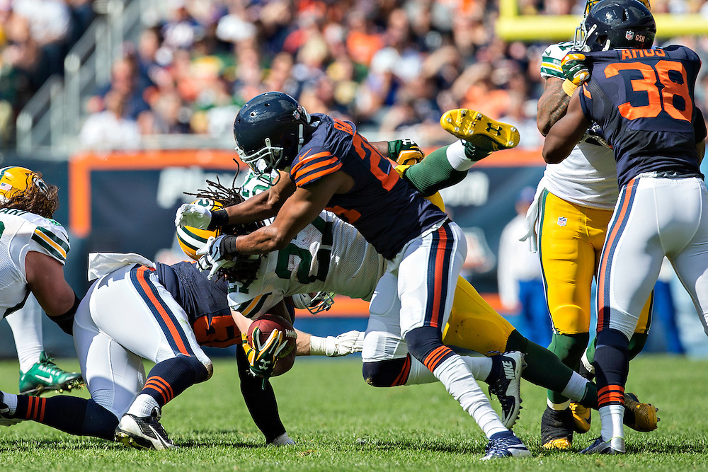 CHICAGO, IL - SEPTEMBER 13:  Eddie Lacy #27 of the Green Bay Packers is tackled by Alan Ball #24 of the Chicago Bears at Soldier Field on September 13, 2015 in Chicago, Illinois.  The Packers defeated the Bears 31-23.  (Photo by Wesley Hitt/Getty Images) *** Local Caption *** Eddie Lacy; Alan Ball