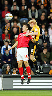 Hull Saturday september 18th, 2010: Paul McShane of Hull City and Chris Cohen of Nottingham Forrest doin battle in the air for possetion during the NPower Championship Match at the KC Stadium,Hull. (Pic by Darren Walker/Focus Images)..