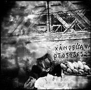 Outdated film picture of a street vendor along Long Bien Bridge, Hanoi, Vietnam, Southeast Asia