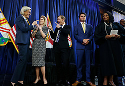 May 1, 2019 - Tampa, Florida, U.S. - Mayor JANE CASTOR smiles with her partner ANA CRUZ and her son SEELY while SERGEI BEVAN and federal Judge MARY SCRIVEN looks on during oath of office ceremony held at Armature Works. (Credit Image: © Octavia Jones/Tampa Bay Times via ZUMA Wire)