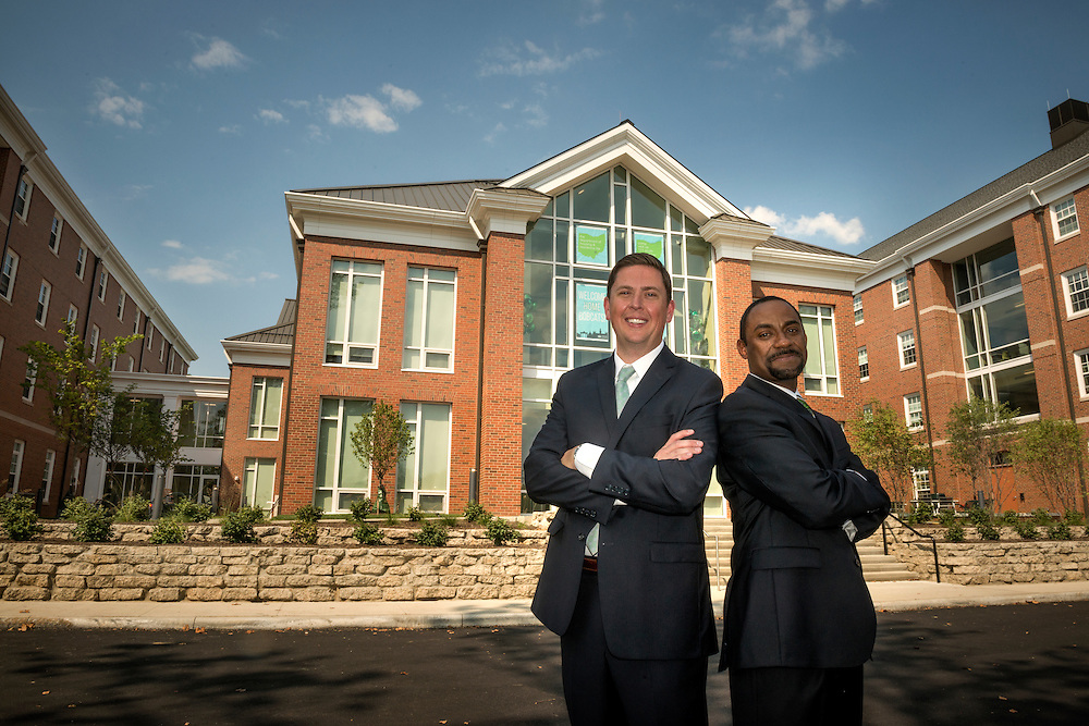 Former Vice Presidents for Student Affairs, Ryan Lombardi [left] and Kent Smith, stand proud in front of the Living Learning Center on the Ohio University campus in Athens, Ohio following the opening ceremony event on Saturday, August 29, 2015 at the. The center, and the surrounding residence halls were part of the Ohio University Residential Housing Phase 1 project that Smith initiated and Lombardi carried through until completion.