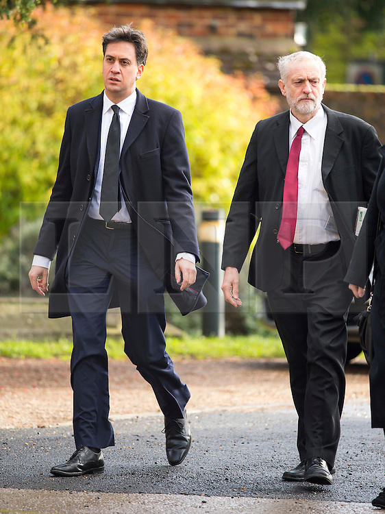 © Licensed to London News Pictures. 13/11/2015. London, UK. Former Labour party leader ED MILIBAND and current Labour party leader JEREMY CORBYN arrive for The funeral of former Labour MP Michael Meacher at St Mary's Church in Wimbledon, south west London.  Michael Meacher, who was a Labour MP in Oldham for over 40 years, served as Minister of State for the Environment in the Tony Blair government.  Photo credit: Ben Cawthra/LNP